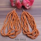 balinese multiple strand beads earrings orange color