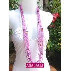 necklace beads long strand multiple seeds shells charm pink