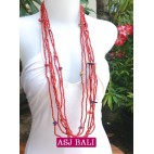 necklace long strand multiple seeds shells charm red