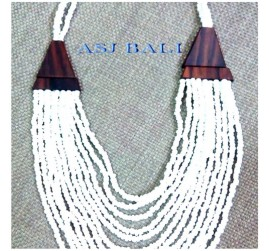 white beads multiple seed necklaces with wooden caps