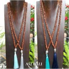 organic wooden brown beads necklace tassels budha heads prayer design