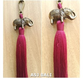 elephant golden chrome tassels keychain long maroon color